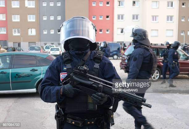 French members of the Research and Intervention Brigade secure the area during a search operation at the Ozanam housing estate in Carcassonne...