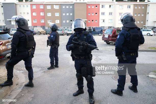 TOPSHOT French members of the Research and Intervention Brigade secure the area during a search operation at the Ozanam housing estate in Carcassonne...