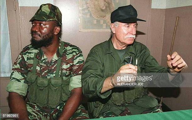 French mercenary Bob Denard and rebel Captain Ayouba Combo speak to the press 04 October after French troops stormed Comoros early 04 October French...