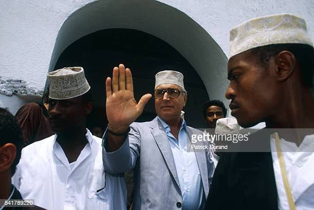 French mercenary Bob Denard leaves the Moroni Mosque flanked by bodyguards of the GP an armed group he was paid to found make a coup and overthrow...