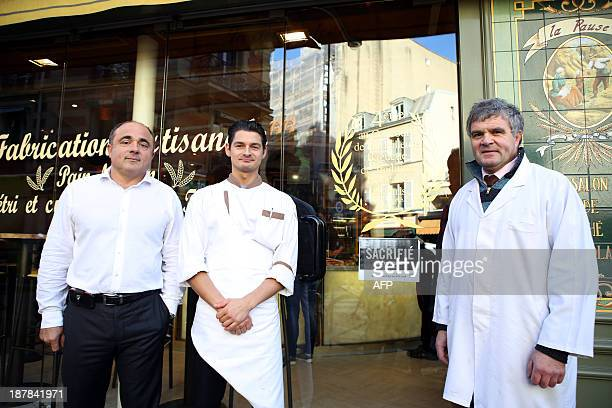 French merchants baker Dominique Anract a butcher from Andre Gauthereau butchery and cheese maker Claude Maret pose outside a bakery on November 13...