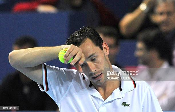 French Michael Llodra reacts during the ATP Open 13 tennis tournament final against Argentinian Juan Martin Del Potro on February 26, 2012 in...