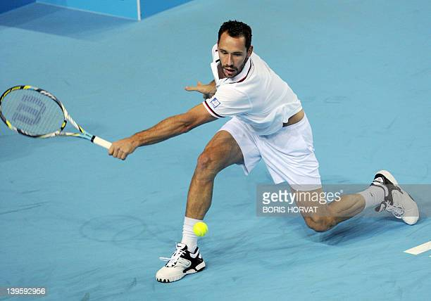 """French Michael Llodra returns to Ukrainien Alexandr Dolgopolov on February 23 in the southern city of Marseille, during the """"Open 13"""" tournamement...."""
