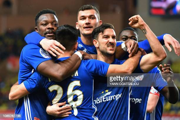 French midfielder Adrien Thomasson celebrates with teammates after scoring a goal during the French L1 football match between Monaco and Strasbourg...