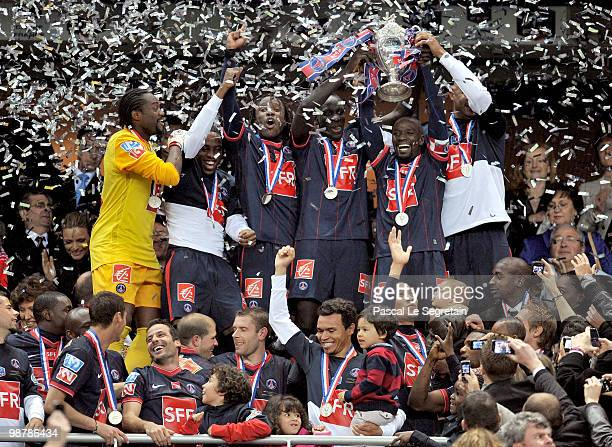 French midfielder and captain Claude Makelele celebrates with the Paris Saint Germain football club teammates after winning the French football Cup...