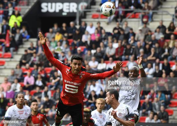 French midfielder Benjamin Andre jumps for the ball during the French L1 football match Rennes versus Montpellier on May 7 2017 at the Roazhon park...