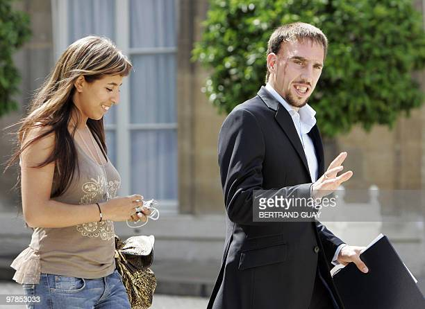 French midfielder Franck Ribery and his wife leave the Elysee palace 10 July 2006 in Paris after a lunch with French President Jacques Chirac upon...