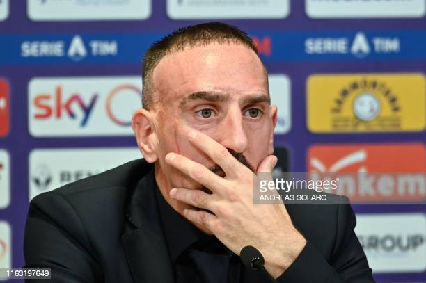 French midfielder Franck Ribery gestures as he speaks to journalists during a press conference held for his presentation as a new player of the...