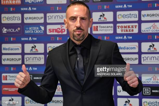 French midfielder Franck Ribery gestures during a press conference held for his presentation as a new player of Fiorentina at the municipal stadium...