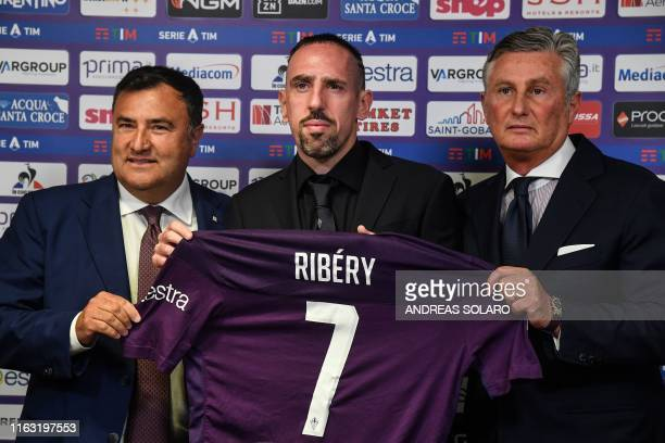 French midfielder Franck Ribery holds his new jersey as he poses with Forientina's sport manager Joe Barone and sport director Daniele Prade during a...