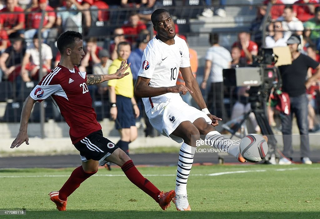 French midfielder Geoffrey Kondogbia (R) vies with Albania's Ergys Kace during a friendly football match Albania vs France on June 13, 2015 in Elbasan, outside Tirana.