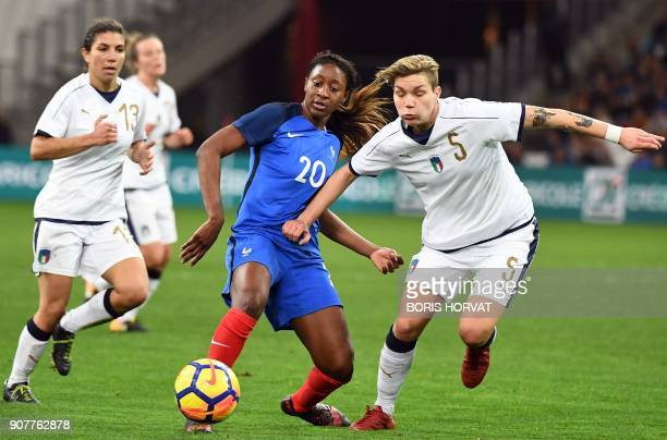 French Midfielder Kadidiatou Diani vies for the ball with Italien defender Elena Linari during the international friendly football match between...