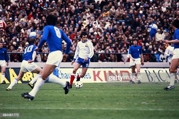 French midfielder Michel Platini vies with Italian players during the 1978 World Cup football match between France and Italy, on June 2 in Mar del...