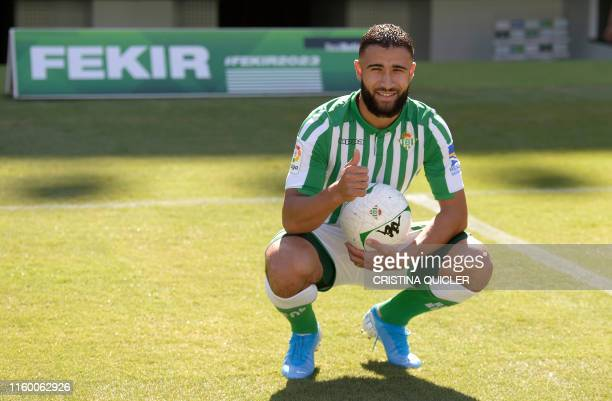 French midfielder Nabil Fekir gives a thumbs up as he poses during his official presentation as new player of Real Betis at the Benito Villamarin...