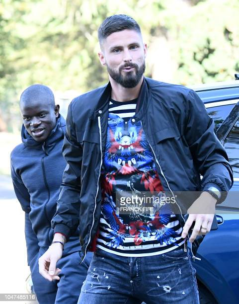 French midfielder N'Golo Kante and forward Olivier Giroud arrive at France's national football team training base in Clairefontaine en Yvelines on...