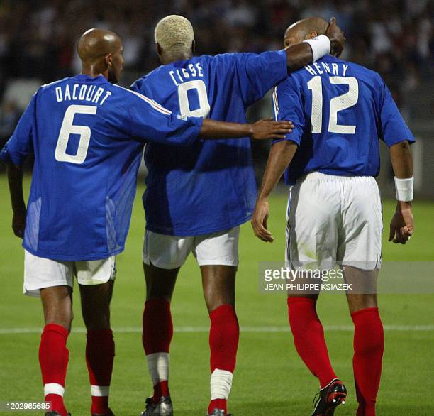 French midfielder Olivier Dacour French forward Djibril Cisse French forward Thierry Henry jubilate after the first goal during their soccer...