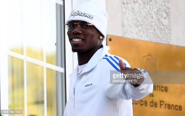 French midfielder Paul Pogba arrives at France's national football team training base in Clairefontaine en Yvelines on October 8 for the team's...