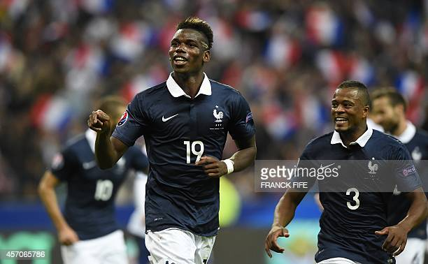 French midfielder Paul Pogba celebrates scoring a goal during the friendly football match France vs Portugal on October 11 2014 at the Stade de...