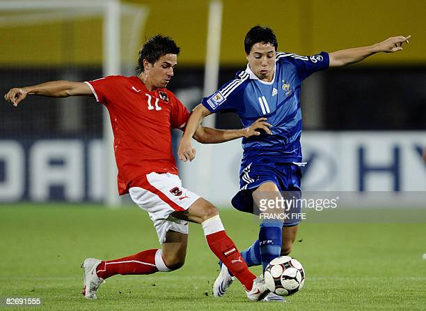 French midfielder Samir Nasri vies with Austrian Martin Harnik during the WC 2010 qualifying football match France vs Austria on September 6 2008 at...