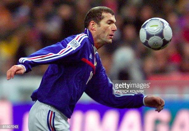 French midfielder Zinedine Zidane eyes the ball during the friendly football match between France and Germany 27 February 2001 at the Stade de France...