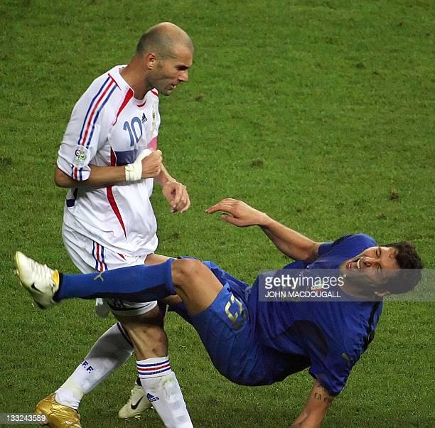 French midfielder Zinedine Zidane gestures after head butting Italian defender Marco Materazzi during the World Cup 2006 final football match between...