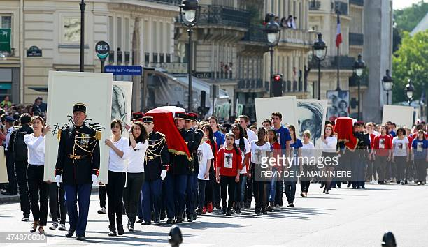 French militaries carry the four flagdraped caskets representing World War II Resistance fighters Genevieve de GaulleAnthonioz Germaine Tillion...