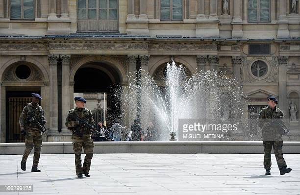 """French militaries patrol on April 11, 2013 at the """"Cour Carree"""" of the Louvre Museum in Paris. Paris's Louvre museum today reopened its doors to the..."""