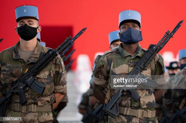 French military '2nd Regiment de Dragons' unit wearing face masks rehearse ahead of the annual Bastille Day military parade at Place de la Concorde...