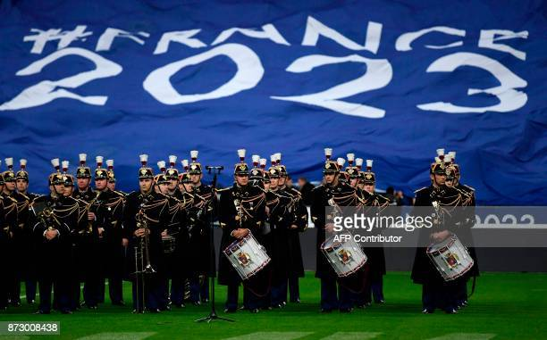 A French military band perform in front of a banner or France's bid for the Rugby World Cup 2023 ahead of the friendly rugby union international Test...