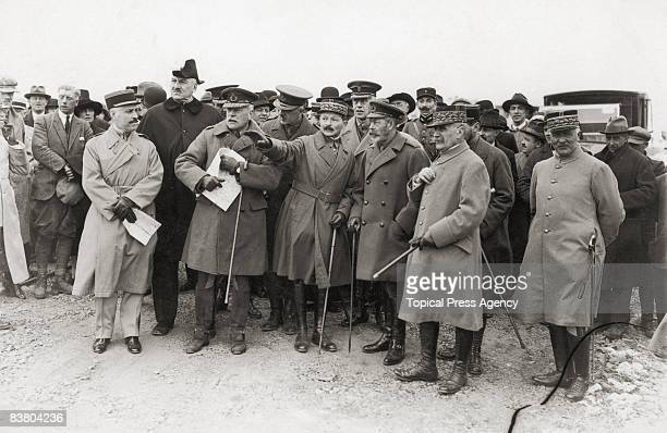 French military commander Maxime Weygand points describes one of the battles of World War I to King George V of Great Britain during a royal visit to...