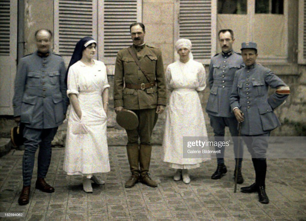 French military doctors and nurses in front of Saint-Paul Hospital during World War I. 1917. Color photo (Autochrome Lumière) by Fernand Cuville (1887-1927). Soissons, Aisne, France.