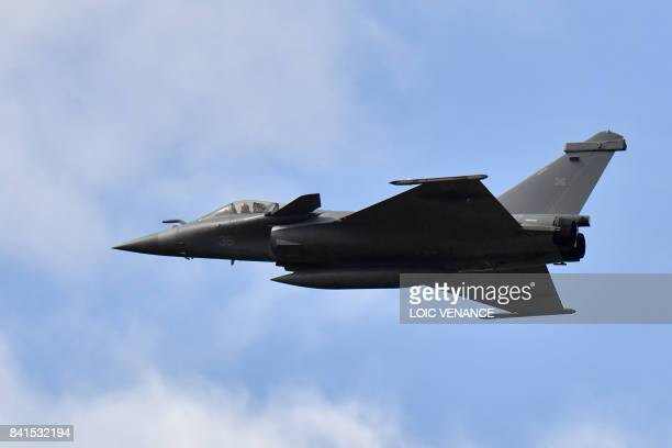 A French military jet fighter Rafale flies over the racetrack of the rallycross of France a stage of the 2017 FIA World Rallycross Championship on...