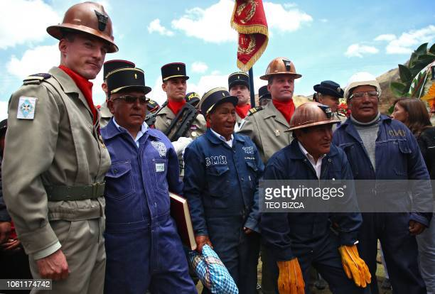 French military men pose with miners during a homage to lieuntenant Francois Aubry who did explorations at Huaron mine and was its first director in...