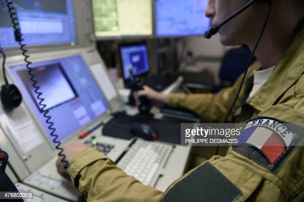 A French military officer pilots an Israeli Harfang drone bought by the French army and used in the Operation Barkhane an antiterrorist operation in...