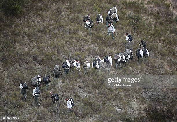 French military personel walk up the mountainside on March 25 2015 near Seyne France Germanwings flight 4U9525 from Barcelona to Duesseldorf has...
