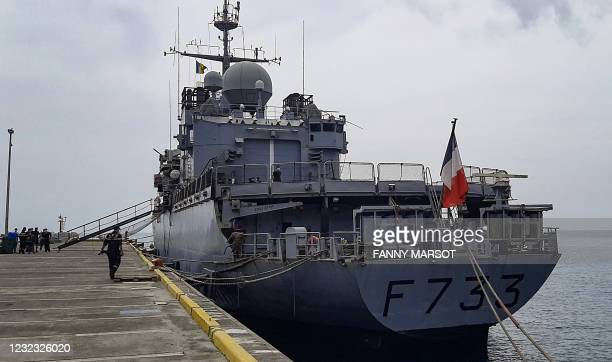 French military personnel unload aid parcels from the Floreal class French frigate Ventose on the island of Saint Vincent and the Grenadines, on...