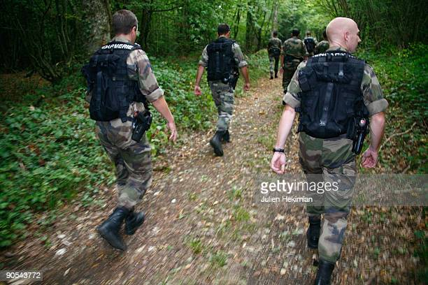 French military police patrol in the forrest of Foret d'Othe in search of the fugitive JeanPierre Treiber on September 10 2009 in Joigny France...