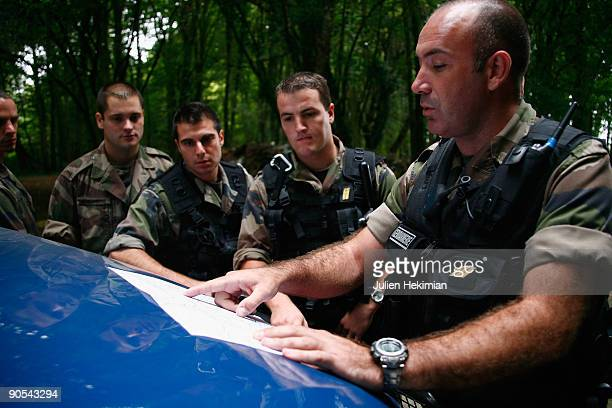 French military police plan a course as they patrol in the forrest of Foret d'Othe in search of the fugitive JeanPierre Treiber on September 10 2009...