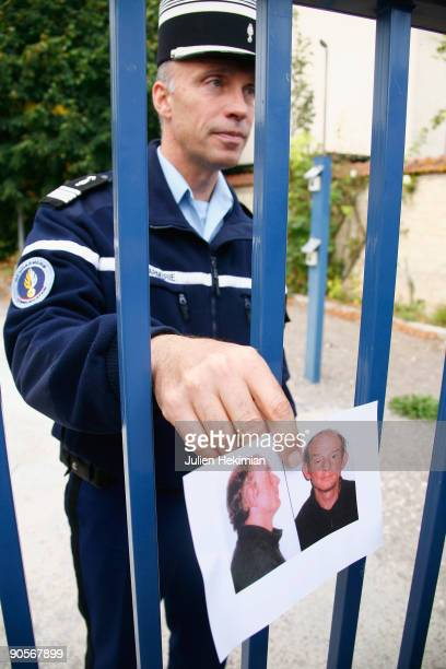 A french military policeman shows an image of fugitive JeanPierre Treiber on September 10 2009 in Joigny France Treiber suspected of double murdering...