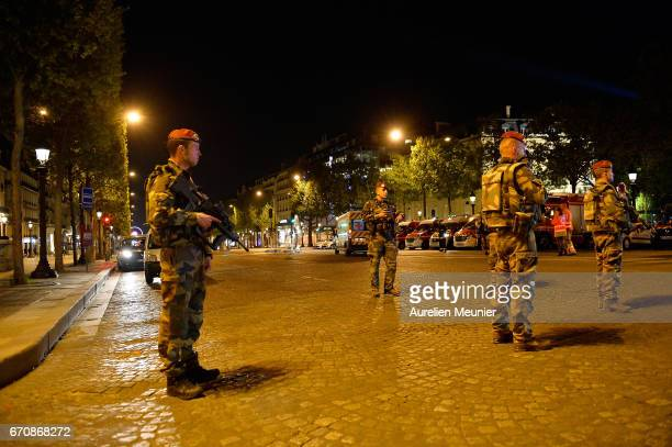 French military secure the area after a gunman opened fire on Champs Elysees on April 20 2017 in Paris France One police officer was killed and...
