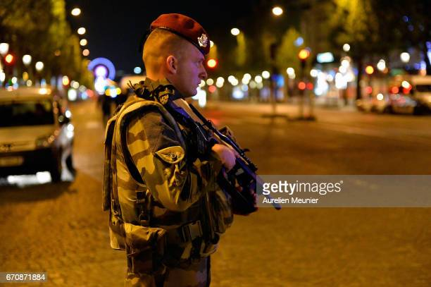 French military secure the area after a gunman opened fire on the Champs Elysees on April 20 2017 in Paris France One police officer was killed and...