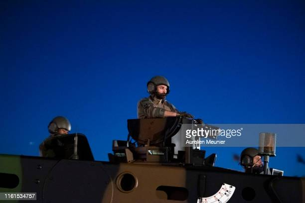 French military stands on tank Leclerc as he drives down the Champs Elysee during the Bastille Day military ceremony rehearsals on July 12, 2019 in...