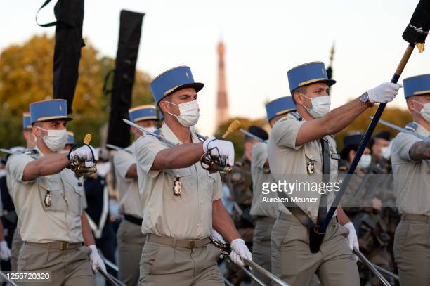 French military wearing face masks rehearse ahead of the annual Bastille Day military parade at Place de la Concorde on July 12 2020 in Paris France...