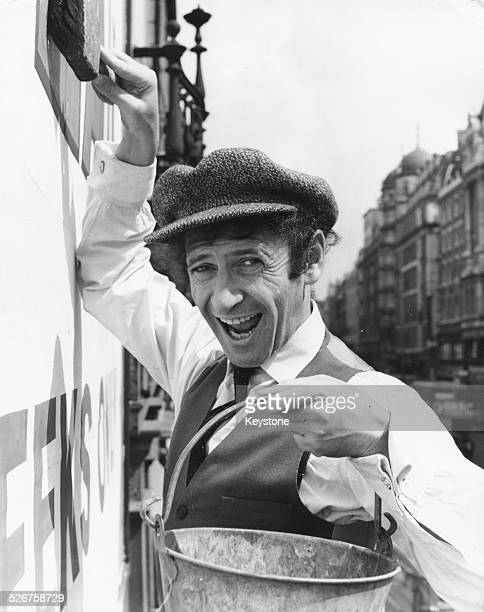 French mime artist Marcel Marceau joking around as a 'paper hanger' outside the Adelphi Theatre, to promote his own show 'The Best of Marceau',...