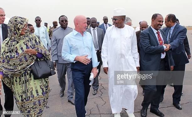 French mineworker and former hostage Thierry Frezier , flanked by Chad's Minister for Security Ahmat Mahamat Bachir , arrives in N'Djamena, on May 8,...