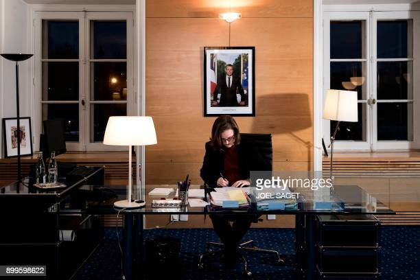 French Minister attached to the Foreign Affairs Minister Nathalie Loiseau poses in her office during a photo session in Paris on December 21 2017 /...