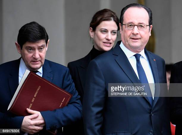 French Minister for Cities Youth and Sport Patrick Kanner and French Junior Minister for Victims Aid Juliette Meadel stands next to French President...