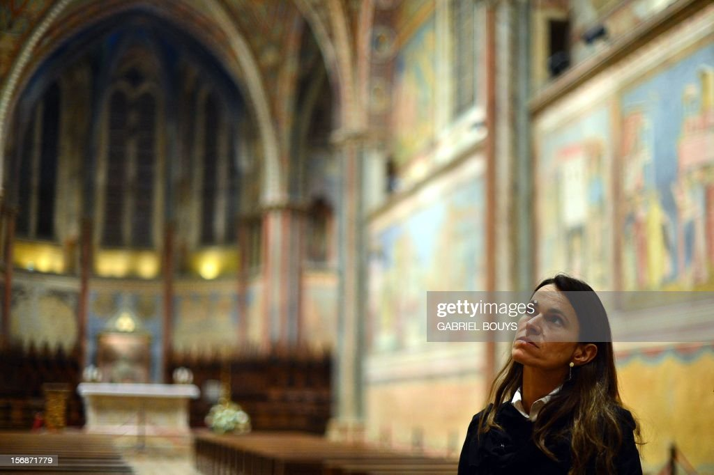 French Minister for Culture and Communication, Aurelie Filippetti visits the Basilica of San Francesco d'Assisi (Saint Francis) in Assisi on November 23, 2012, during a two-days official visit in Italy.