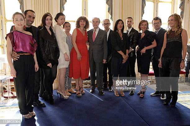 French Minister for Culture Frederic Mitterrand and Editor and Chief of ELLE Valerie Toranian poses with the winners of the 'ELLE Les Nouveaux...