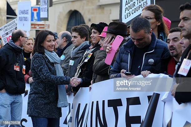 French Minister for Equality of Territories and Housing Cecile Duflot arrives for a demonstration for the legalisation of gay marriage and parenting...